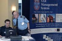 PawPrint President Scott Baker shows CCGA-P Member Jack Dennis how the system works.